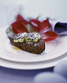 Beef fillet with herb butter and radicchio
