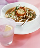 Onion soup with grated cheese and toasted bread