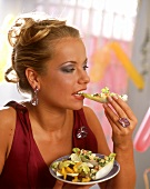 Young woman eating chicory snack