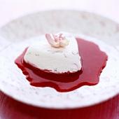 Cream cheese heart on raspberry sauce