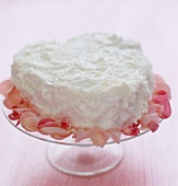 Heart-shaped coconut cake with rose petals