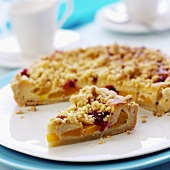 Peach crumble tart with raspberries