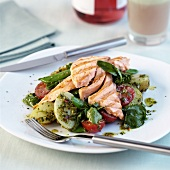Salmon fillet on lettuce with herb dressing