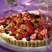 Strawberry and blueberry flan with vanilla cream & almonds