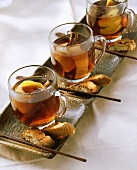 Three cups of cherry and amaretto punch