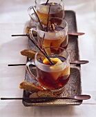 Three cups of cherry & amaretto punch with sloe juice