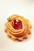 Piped biscuits with redcurrant jelly on butter biscuits