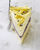 A piece of white chocolate and lavender cake