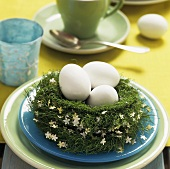 Easter nest with three white eggs