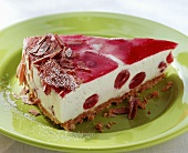 A piece of yoghurt cherry cheesecake with grated chocolate