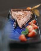 A piece of chocolate strawberry cream tart