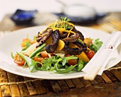 Rocket salad with strips of roast meat and oranges