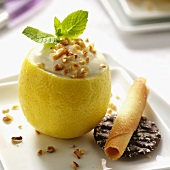 Lemon mousse with almonds in hollowed out lemon
