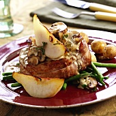 Pork fillet with mushroom & cream sauce and pear wedges