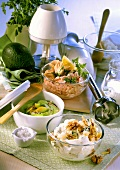 Cheese dip, avocado dip and tuna dip with kitchen utensils