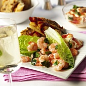 Shrimps with lettuce leaves, pepper sauce & chili bread