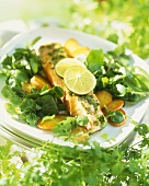 Salmon trout with fried potatoes and watercress