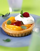 Peach tartlet with berries and cream