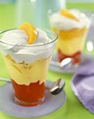 Layered peach and cherry dessert with cream