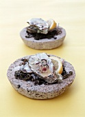 Oysters with seaweed in stone bowl