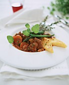 Lamb and vegetable ragout with polenta diamonds