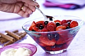 Berry salad and a bowl of cream