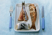 Rollmops, matjes herring fillet and fried herring on plate