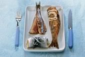 Rollmops, matjes herring fillet and fried herring on plate