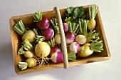 Various turnips in wooden basket