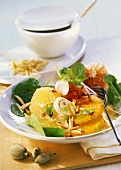 Savoury citrus fruit salad with onions, spinach and almonds