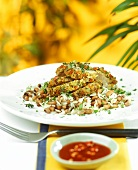 Pork fillet with vegetable crust on rice and beans