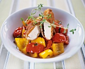Chicken breast in zwieback (rusk) panade on peppers