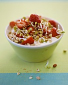 Muesli with yoghurt, sprouts and strawberries