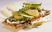 Crispbread topped with Harz cheese and cucumber slices