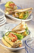 Two sandwiches with shrimp salad and chicken salad