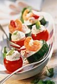 Stuffed tomatoes and cucumber rounds with shrimps