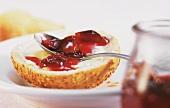 Sesame roll with plum preserve