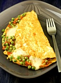 Omelette with cheese and vegetable filling