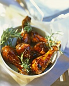 Baked chicken thighs with honey glaze and rosemary