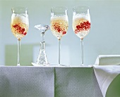 Champagne jelly with redcurrants in glasses