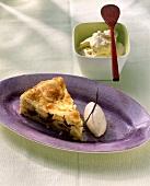 A piece of apple pie with vanilla ice cream