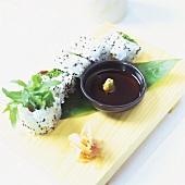 Vegetarian sushi (California rolls) soy sauce, wasabi, ginger