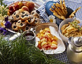 Picnic with muffins, kebabs, savoury sticks, pasties