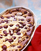 Sweet cherry pudding with flaked almonds