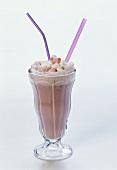 Hot raspberry milk with marshmallows