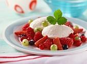 Yoghurt dumplings on fresh sugared berries