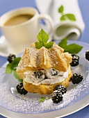 Cream puff with blackberry cream