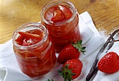 Strawberry and rhubarb preserve in jam jars