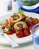 Stuffed pork roulades with cherry tomatoes