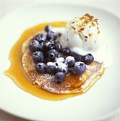 Pancakes with blueberries, maple syrup & vanilla ice cream